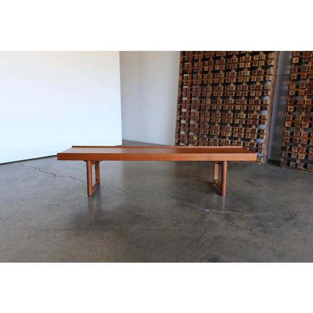 """Teak """"Krobo'' bench by Torbjørn Afdal for Bruksbo with original labels."""