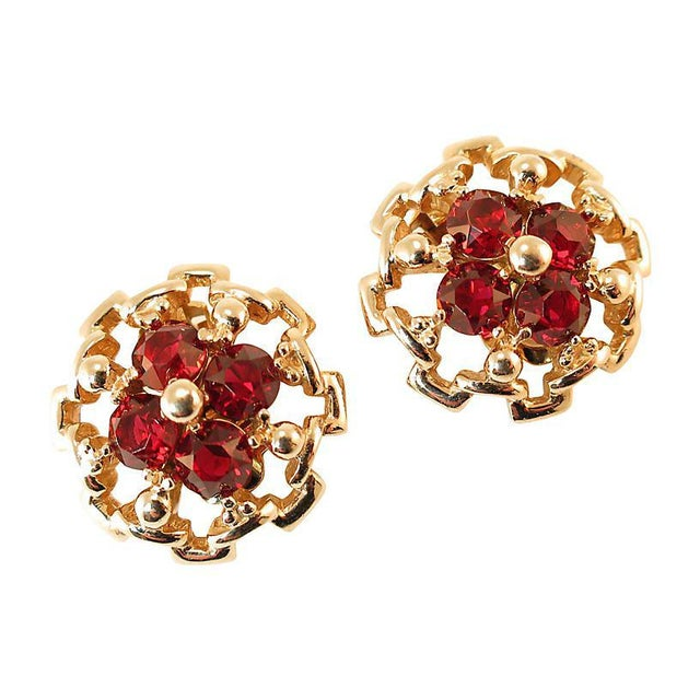 Offered here is a pair of Reja gold-plated sterling clip-back earrings from the 1940s. The slightly domed round structure...