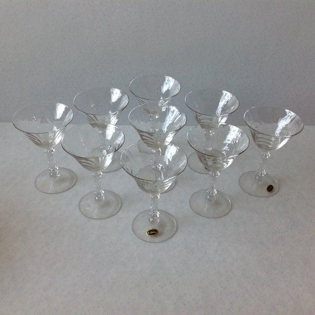 A set of nine, genuine, hand made, Cambridge crystal glass stemware. 3 of the glasses still have the original foil labels...
