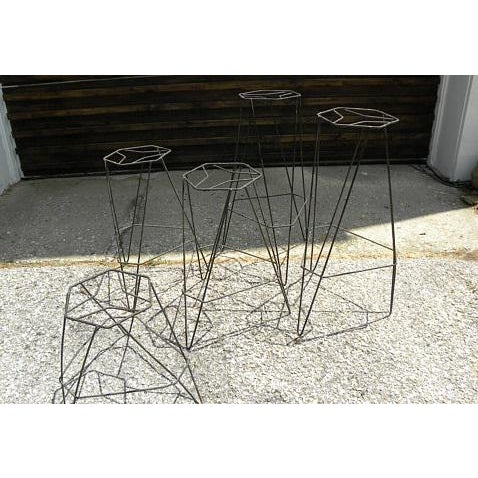 Very cool ---vintage mid century atomic age plant stands. They have a very architectural feel about them. Geometric...