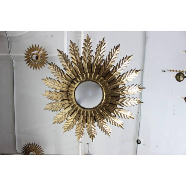 Spanish gilt metal ceiling fixture with decorative leaf pattern. The fixture is wired for a single candelabra bulb that...
