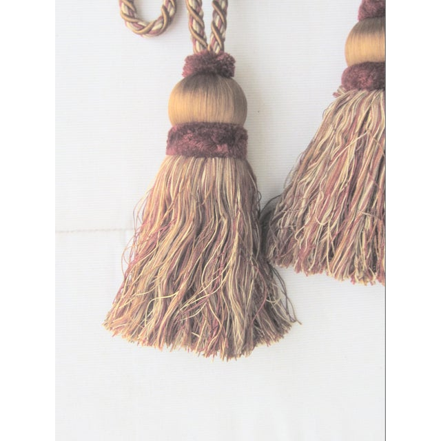 Very Large tassel tie backs. tassels measure 8'' without cord. colors: Maroon, gold, and tan
