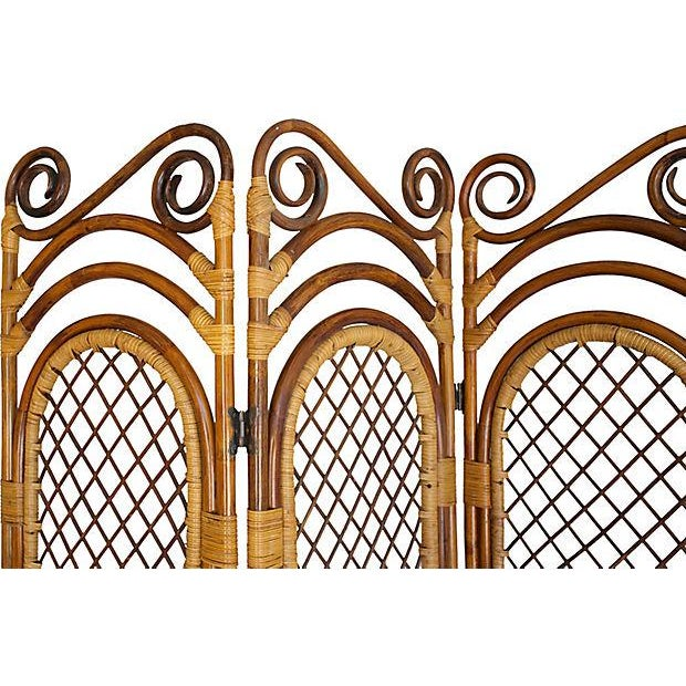 Bamboo four panel collapsable room screen with butterfly hinges. Minor tarnish to hinges.