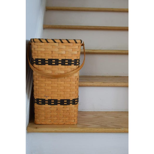 Made by the masters, the Amish, this basket is absolutely stunning. The basket is woven with a tan wood (possibly oak)...