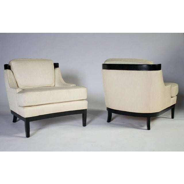 Classic pair of 1960s Hollywood Regency lounge chairs by Erwin Lambeth for Tomlinson. Black lacquered wood frame and...