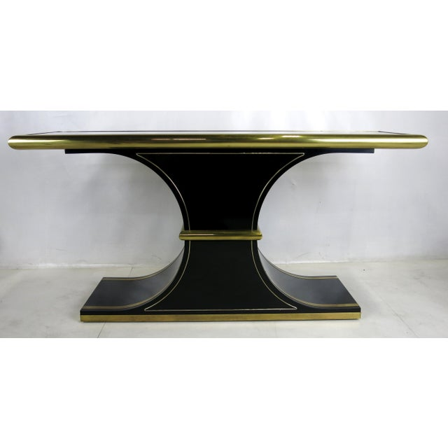 Sophisticated Black Lacquer Console with Brass Trim in the inimitable style of Mastercraft. Finest quality materials and...