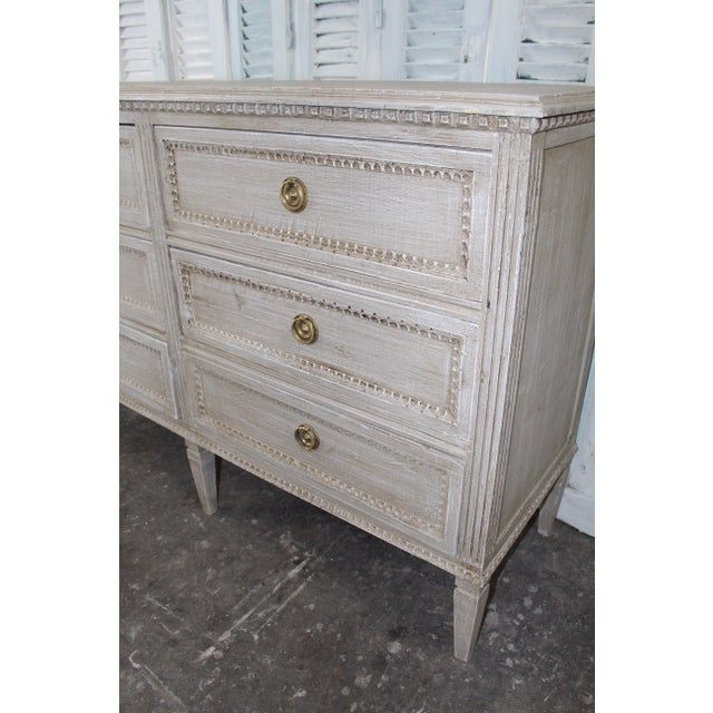 Gorgeous vintage Swedish dresser with six fitted drawers. Each drawer of this piece is outlined with beautiful dentil...