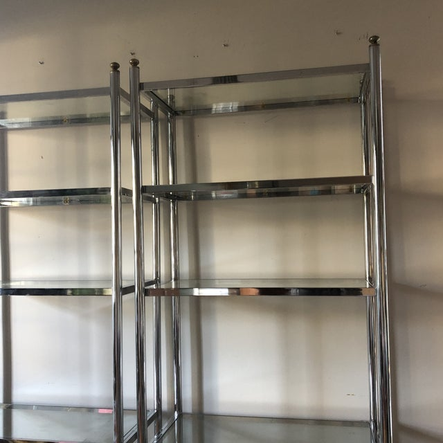 Absolutely gorgeous chrome shelves in the mid century styling. Chrome in beautiful condition. Recently re-polish. Glass...