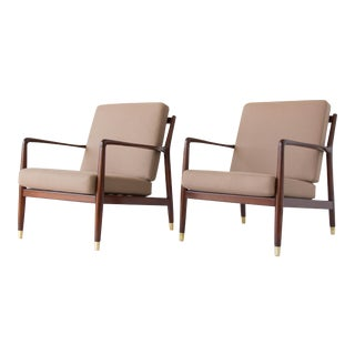 Pair of Lounge Chairs with Brass-Capped Legs by Folke Ohlsson for DUX For Sale