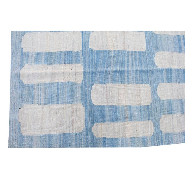 This gorgeous rug has a unique and bold pattern, perfect for a modern, mid-century modern, or traditional home! Great...