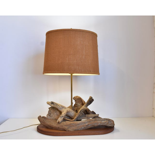 This mid-century driftwood lamp is made of a great selection of aged driftwood assembled in an organic arrangement. The...