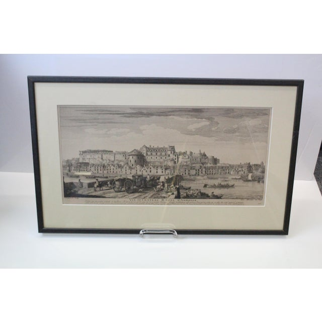 City print in black and white of a French river and citadel. In white mat with glass and black frame. Mid 1700s print in...