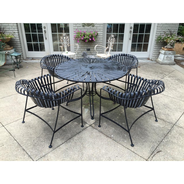 """Mid century american outdoor patio set. Four arm chairs and table included. Dimensions of chairs: 30""""wide x 23""""deep x..."""