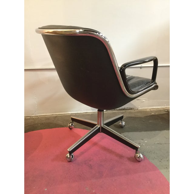 Charles Pollack for Knoll executive chair. Cushioned black leather seat and back, chrome accents and resin shell. Very...