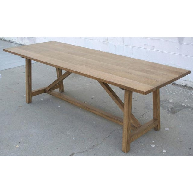 Dining table in distressed, rift-sawn, white oak. Each table is bench-made in our own Los Angeles workshop. We use only...