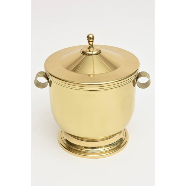 The classical lines and timelessness of this period Mid-Century Modern Tommi Parzinger polished brass and Pyrex glass...