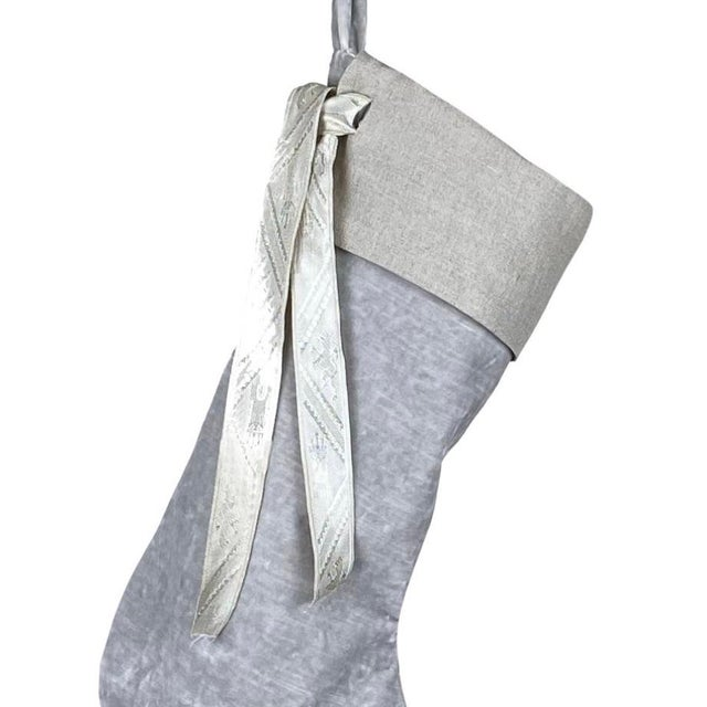 Custom silver French velvet stocking with removable linen collar and vintage French jacquard ribbon. The stocking is lined...