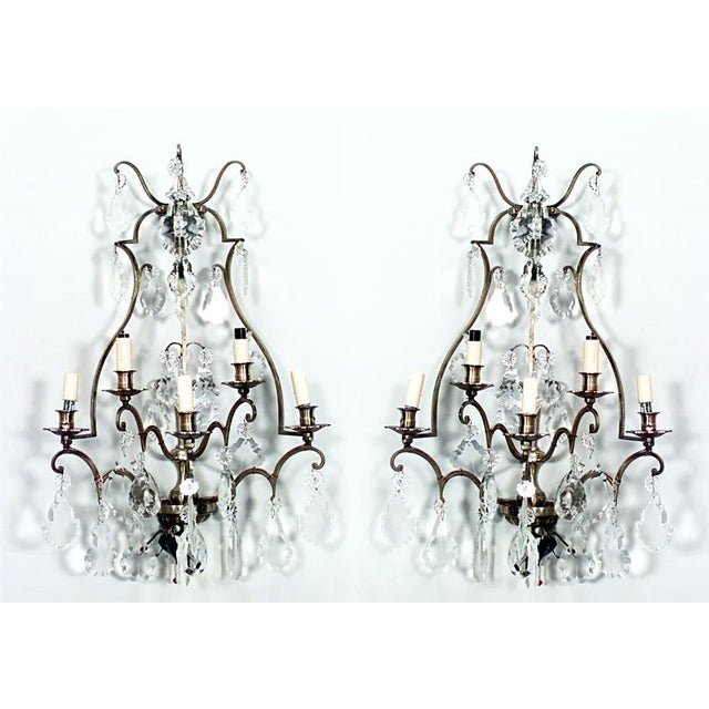 Pair of French Louis XV style cut-glass and lacquered brass five-arm wall sconces (20th Century).