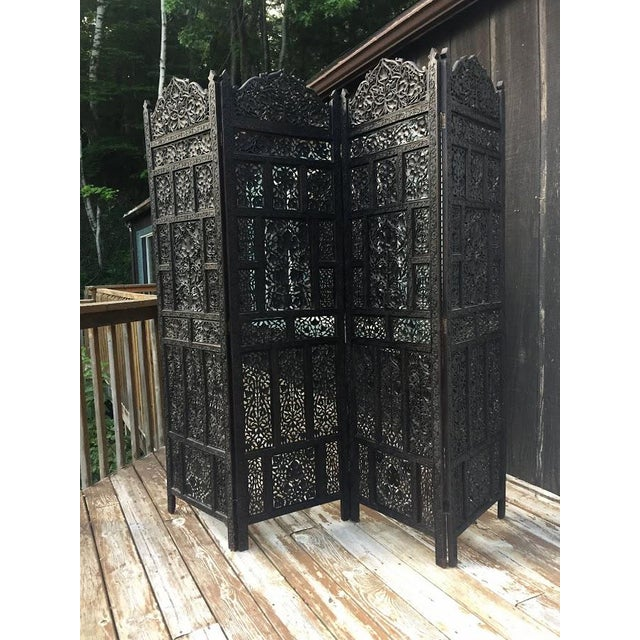 Beautiful 4-panel hand carved wood screen/room divider. This screen is embellished with an intricate floral, leaf and...