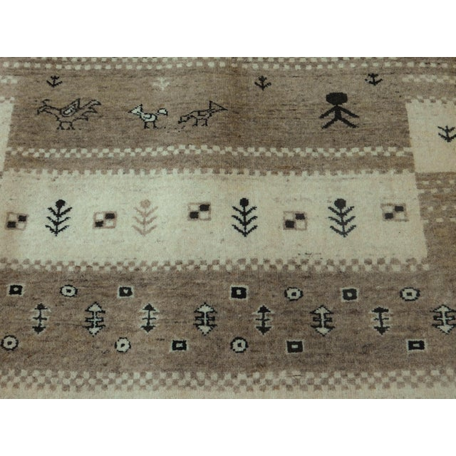 Hand-knotted Tribal Runner Origin: India Material: Natural undyed wool.