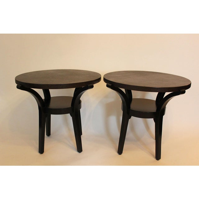 These end tables were designed by Barry Goralnick and made by the Karl Springer workshops. The chocolate dark brown tops...