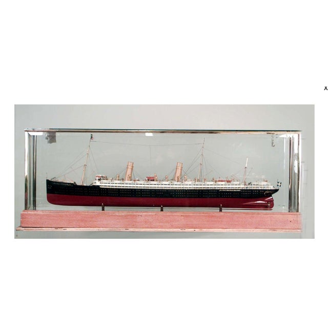Ship model of Swedish luxury liner with red and black painted hull in glass case with oak base and brass trim (SS...