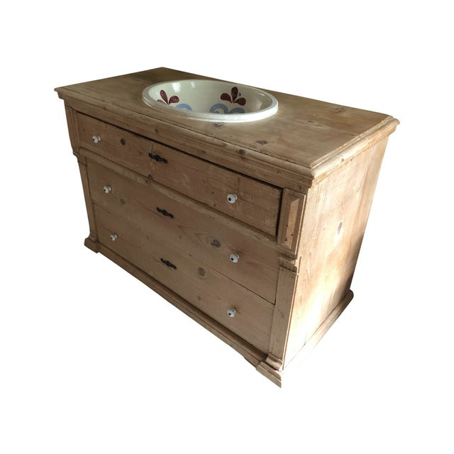 This distressed, waxed pine dresser was customized to include a drop-in Talavera sink. The top drawer is cut to...