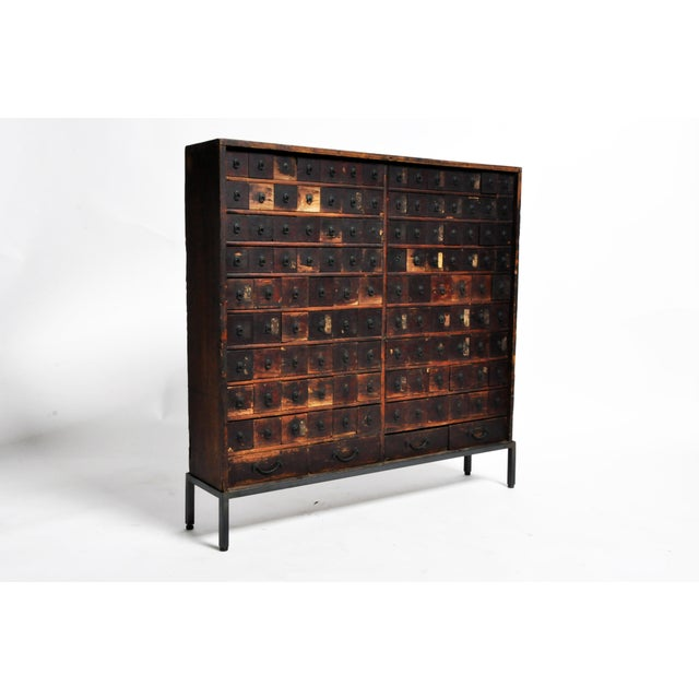 This personal medicine chest with is from Japan and is made from paulowina wood. The piece has been raised on a custom...
