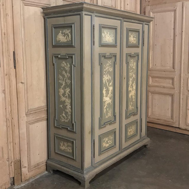 Early 19th Century Italian Neoclassical Painted Armoire represents the epitome of master Italian craftsmanship and...