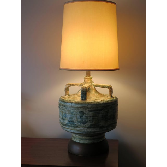 """A fantastic, large and impressive Raymor ceramic lamp. Measures approximately 34.5"""" H, 18"""" (ceramic), 14.5"""" D. Includes..."""