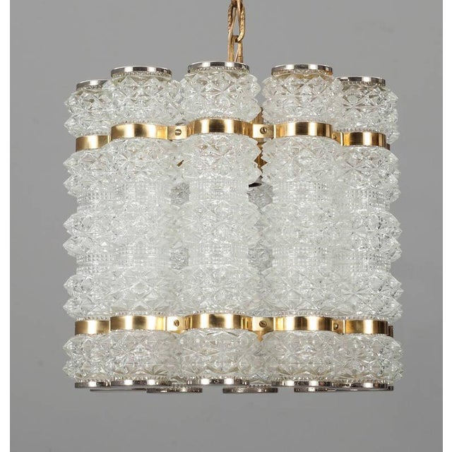 A Pendant by Konst Hant Verk Tyringe, Sweden. Circa 1960th-70s. Glass probably by Orrefors. Cut glass , polished nickel...