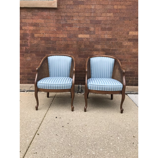 Pair of vintage cane barrel chairs. Comfortable and sturdy. Original Blue Fabric. Cane Intact. Cabriole legs. Great condition