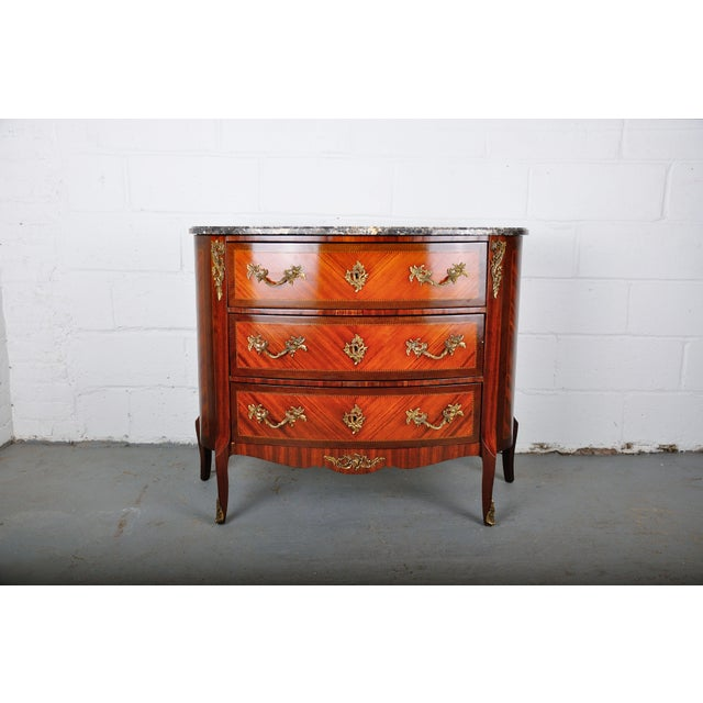 Louis XV style commode made of solid mahogany wood with beautiful inlay marquetry. Besides its beautiful inlay work, this...