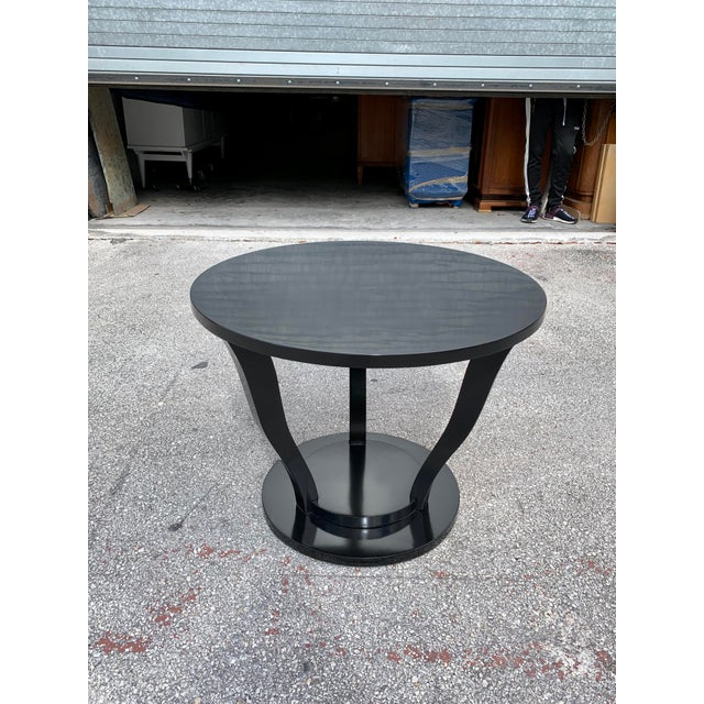 classic French Art Deco accent table circa 1940s. Made of mahogany, the mahogany wood has been ebonized and finished with...