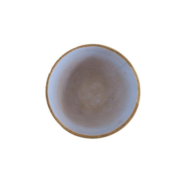 "Vintage light blue glazed stoneware mixing bowl. Measures 8 3/4"" across x 4 1/2"" h."