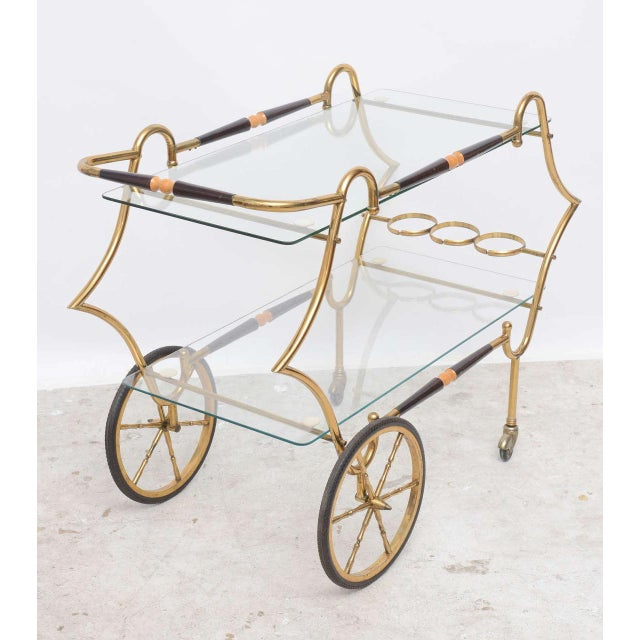 1950s Italian Brass & Glass Trolley Serving or bar cart, 2-tiered with bottle rests, stretcher side bars upper and lower...