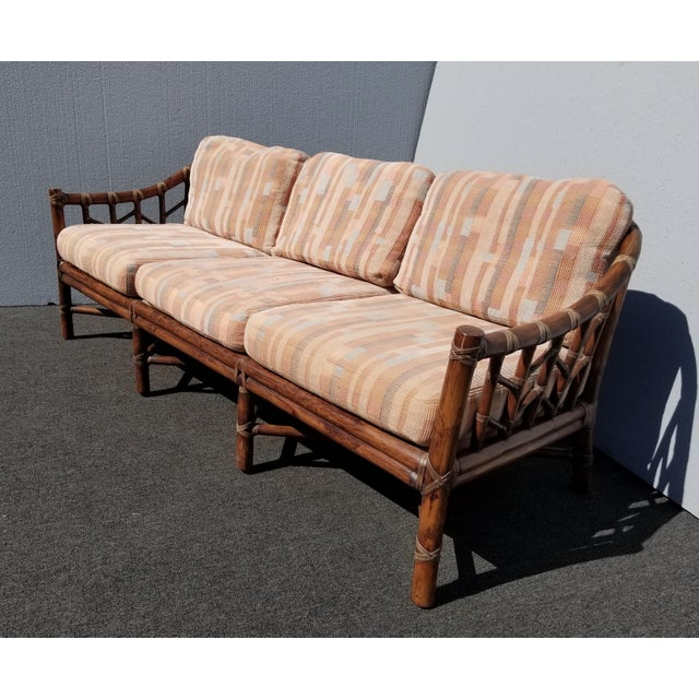 Vintage McGuire Furniture Company Rattan Sofa with Leather Rawhide Ties Gorgeous Sofa in Good Vintage Condition. It is...