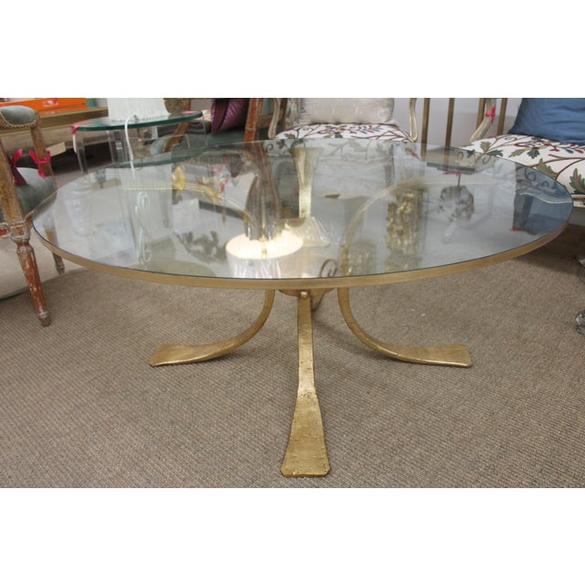 Beautiful coffee table with gilded base, made of very heavy iron. New base and glass, brand new, made in High Point, North...