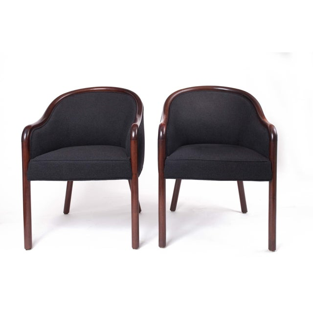 A graceful pair of lounge armchairs by Ward Bennett for Brickel Associates, with sinuous Bauhaus-influenced arms, a plush...