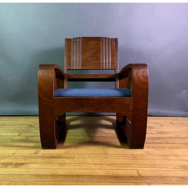 Art Deco period Veranda chair made from solid teak. Gorgeous curve to arm. Back and side panel with hand-carved bead-work,...