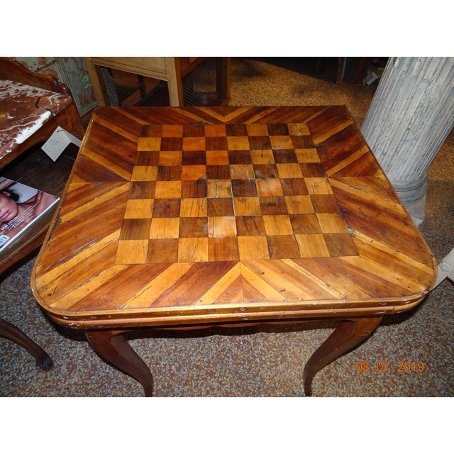 French 18th century chess marquetry game table. Louis XV epoch , curved apron, cabriole legs. The table opens and double...