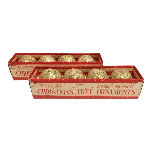 This sparkly set of 8 metallic gold ball ornaments are decorated with glitter and sequins. Add some bling to your tree or...