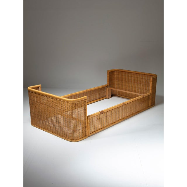 Set of two single-bed frame by Adalberto Dal Lago for Germa. Full surface covered with warm wicker texture. Also available...