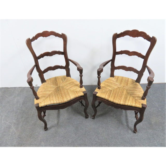 Pair of Country French Mahogany frame Arm chairs with rush seats