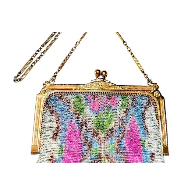 Circa 1920s to 1930s Whiting & Davis delicate gold tone metal mesh purse embellished with a bright floral motif, hanging...