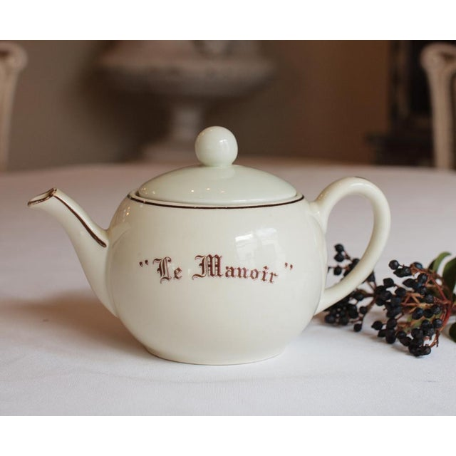 """This rare and wonderful large vintage """"Le Manoir"""" teapot is part of lot of restaurant-ware acquired from the small town of..."""