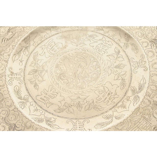 Chinese Import hand-carved brass tray coffee table. Nicely hand-carved with Chinese writing and dragons scenes. Beautiful...
