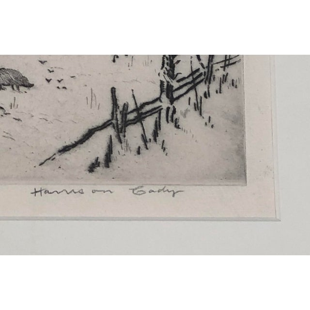 A framed etching by Harrison Cady (American, 1877-1970) of mountain farms near the village of Spruce Pine, N.C. depicting...