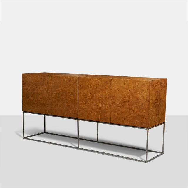 Tall burlwood credenza by Milo Baughman for Thayer Coggin. Beautiful olive wood case supported by open chromed steel base....