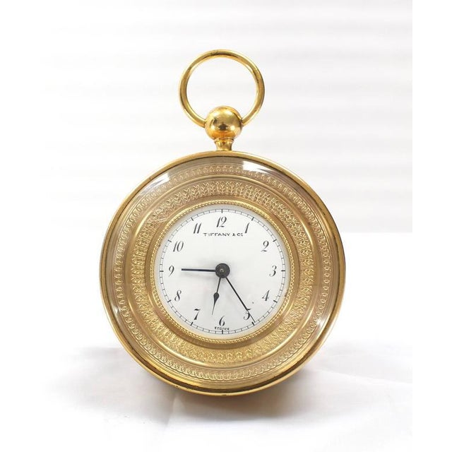 Very nice antique Tiffany bronze travel alarm clock. Clock is in good working condition. One of the original crowns...